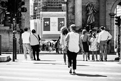 Crossing (lorenzoviolone) Tags: blackandwhite bw monochrome trafficlight blackwhite reflex nikon gate strangers streetphotography streetphoto dslr crosswalk crossway fav10 agfascala200 popolossquare vsco d5200 crosswalking streetphotobw nikond5200 vscofilm flaminiosuqare photomarathon:rome=2016