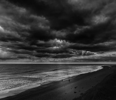 Heavenly Spotlight (miniwaites) Tags: ocean trees light sea england sky blackandwhite cliff cloud beach water monochrome clouds walking mono suffolk sand heaven waves moody unitedkingdom sony wave spotlight shore gb nik walkers heavenly lightrays sizewell nex a6000 niksuite