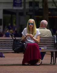 Lunch Downtown (swong95765) Tags: park city food woman lady female bench lunch break eating shades grapes blonde