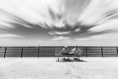 Ladies & the sea (GBen) Tags: savoring enjoying bench feralag ladies two viewpoint sea summer bw serenity travel calmness tranquility relish sky seascape cloudy spain sumarfr vacation