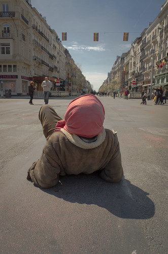 Homeless man focuses on the horizon. Brussels, May Day 2016.