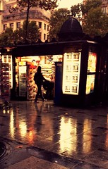 The threatened kiosque (The Big Jiggety) Tags: paris france champselyses kiosque newspapervendor rain lluvia piova regen pluie reflet twilight crepuscule crepusculo