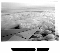 Good Bye, Lenin! (ViannaVi) Tags: travel sky bw film clouds analog plane airplane carpet fly bn