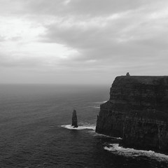 Cliffs with O'Brien's Tower (lennox_mcdough) Tags: ocean ireland sea bw cliff building tower water canon eos coast atlantic cliffsofmoher atlanticocean countyclare liscannor éire obrienstower reddit aillteanmhothair 5dmarkii canonef40mmf28stm takenin2013