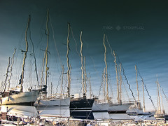 Marina Reflection (Mark Stoeffler) Tags: blue reflection water marina reflections boats reflecting harbor marine sailing upsidedown harbour row calm maritime mooring yachts masts moored markstoeffler