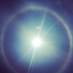 There is a rainbow around the sun. Not sure this picture does it justice. (AbbyB.) Tags: square squareformat amaro iphoneography instagramapp uploaded:by=instagram