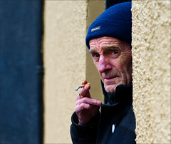No Sign of Spring! (csh 22) Tags: street city portrait people face 50mm glasgow cigarette streetphotography streetportrait doorway smoker gallowgate peopleinthecity nosignofspring nikond7000 glasgowstreetphotography glasgowcharacter glasgowstreetportrait glasgowface