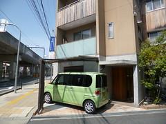 A well parked car (seikinsou) Tags: street house car japan spring pavement space parking railway line osaka footpath