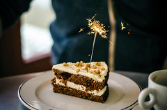Sparkler (Melissa Maples) Tags: birthday food man english cake turkey dessert 50mm restaurant nikon asia trkiye josh antalya nikkor sparkler carrotcake afs kitchenette  vanillacream  50mmf18g f18g d5100