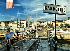 Welcome to Bardolino (mrtungsten62-ON/OFF) Tags: city people italy water ferry clouds see boat meer europe italia village flag magic skipper police tourists clear casio captain mystic eta gardameer lakegarda lagodigarda bardolino mrtungsten62 frankvandongen