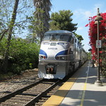Amtrac at train station San Juan Capistrano, CA  5-15-2013.  Runs from San Diego to Los Angeles - maybe 125 miles and 2 to 3 hours.  Northbound trains (here) have the engine at the rear of the train.  Saves turning around in San Diego. thumbnail