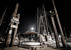 Full Moon Over The Bay (tonygmonk) Tags: lighting nightphotography blackandwhite bw moon canada night canon landscape boats spring dock scenery bc harbour britishcolumbia ships fullmoon vancouverisland 7d