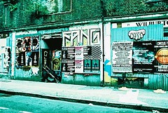 Derelict Row (Cris Ward) Tags: street city summer people urban sun streetart streets colour green slr london abandoned film analog 35mm walking prime graffiti daylight high lomo xpro lomography crossprocessed aqua closed paint fuji market decay turquoise vibrant crossprocess 28mm over sunny wideangle slide highlights velvia crossprocessing m42 fujifilm analogue manual colourful 50 fujichrome derelict e6 yashica exposed rundown blown colorshift shutdown velvia50 petticoatlane c41 colourshift prinzflex fujichromevelvia50 toynbeestreet yashicafxd lomographyuk