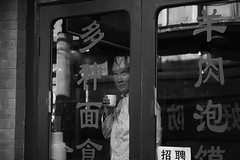 Beijing Hudong 2009. (Stefano-Bosso) Tags: china travel people blackandwhite bw monochrome shop photography mono blackwhite travels noiretblanc chinese beijing cook hooding btw blackwhitephotos stefanobosso