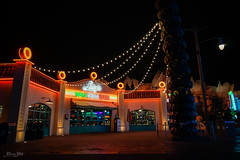 Luigi's Casa Della Tires (Carrie Cole Photography) Tags: california park longexposure nightphotography sunset usa cars tourism night zeiss saturated disneyland scenic disney springs land radiator themepark a7 californiaadventure sonyalpha radiatorsprings sonya7 carriecole