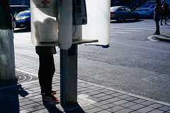Phone call (kevin_lu_80) Tags: china street morning public call phone telephone beijing commuter