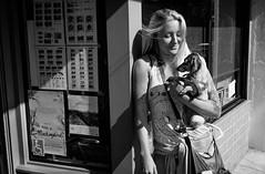 (feldmanrick) Tags: street light blackandwhite bw woman dog monochrome fuji streetphotography streetportrait fujifilm unposed rickfeldman x100t