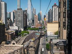 Heading high above the city 'scrapers (ho_hokus) Tags: nyc newyorkcity newyork spring manhattan queensborobridge rooseveltisland 59thstreetbridge rooseveltislandtram 2016 edkochqueensborobridge fujix20 fujifilmx20