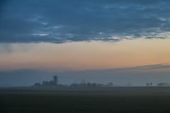 Misty dawn (Infomastern) Tags: morning sky cloud mist fog sunrise landscape dawn countryside himmel soluppgng morgon landskap dimma moln landsbygd gryning