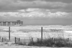 Fort Walton Beach (KaDeWeGirl) Tags: ocean bw storm beach clouds fence pier sand waves florida fort dune walton