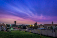 Moody Evening (Jonathan Horne) Tags: longexposure sunset colour grass clouds landscape evening cityscape