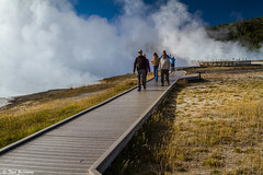 Crossing the geyser field (Thad Zajdowicz) Tags: blue autumn sky people white color green fall nature digital canon season outside eos nationalpark outdoor vibrant vivid roadtrip steam 7d yellowstone wyoming dslr americanwest lightroom geyserfield zajdowicz