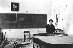 A soldier plays piano in ruined school during a war, behind him is a photo of Tito, Bosnia and Herzegovina 1992. [500 x 239] #HistoryPorn #history #retro http://ift.tt/20wx67S (Histolines) Tags: school history him soldier during is photo war bosnia piano x retro herzegovina timeline tito 1992 plays behind 500 ruined 239 vinatage a historyporn histolines httpifttt20wx67s