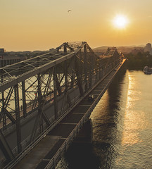 Drive Towards the Light (Peggy Skof) Tags: sunset sun ontario canada water river gold golden ottawa ottawariver goldenhour alexandriabridge nikond5200