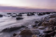 Marino Rocks at Sunset (Caramel Kisses Photography) Tags: ocean sunset beach beauty canon landscape rocks waves purple australia slowshutter adelaide southaustralia marinorocks creamywaves