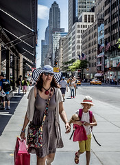 Hats - woman and child on Fifth Ave. (jafleming3) Tags: nyc hats streetphotography fifthavenue bnw
