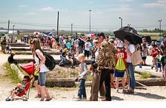 Waiting (wyojones) Tags: texas deerpark houston sanjacintobattlefieldstatehistoricalpark sanjacintoday sanjacintobattlereenactment parking lines people wait frustration shelllot wyojones