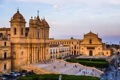 PIAZZA MUNICIPIO - NOTO - SICILY (GIO_CRIS) Tags: road above street vacation people italy holiday building tourism church horizontal architecture stairs buildings square outside person photography photo italian europe cityscape exterior view cathedral famous sightseeing steps picture noto landmark tourist tourists unescoworldheritagesite unesco worldheritagesite nighttime sicily duomo baroque 1001nights visiting townscape viewpoint stnicholascathedral iconic romancatholic dps sicilian placeofworship travelphotography baroquearchitecture touristdestination valdinoto doublepagespread elevatedview photoof piazzadelmunicipio pictureof holidaydestination churchofsansalvatore travelphotographer saintnicholascathedral notocathedral cattedraledinoto southeasternsicily southeastsicily lachiesamadredisannicol basilicacattedraledisannicol basilicasansalvatore sicilianbaroquearchitecture latebaroquetownsofthevaldinoto sansalvatorechurch