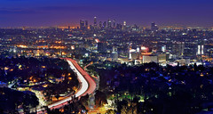 Light Trails Through the City (Rebecca Ang) Tags: california ca city morning light usa skyline architecture dark dawn la losangeles twilight cityscape lighttrails bluehour losangelesskyline traffictrails thebluehour laskyline rebeccaang