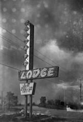 Lodge (LowerDarnley) Tags: stylex herbertgeorgecameraco 6x9 620film expiredfilm dandipan santafe newmexico sign lodge santafelodge route66 motel southwest damagedfilm backingpaper