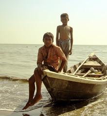 Where the sun meets water... (Protikz Flikz) Tags: bangladeshriver bangladeshwaterbody bangladeshboat bangladesh coastal boat children patuakhali bangladeshi