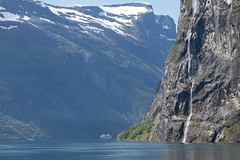 Dwarfed by nature (PeterYoung1.) Tags: mountains nature water beautiful norway canon landscape norge scenic falls hills fjord atmospheric geiranger canon100400 geirangerfjord peteryoung1