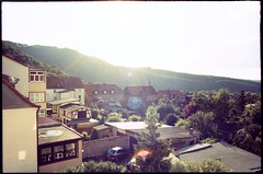 Thale (Monsieur Okkult-Okular) Tags: travel sun sunlight mountains color colour film colors analog 35mm germany lens prime iso100 daylight town xpro crossprocessed colours fuji canoneos30 outdoor grain naturallight wideangle scan retro tokina scanned 100 28 analogue 24mm expired manualfocus f28 korn harz sunnyday rmc gegenlicht intothesun weitwinkel ostharz c41 oldfilm northerngermany thale intothelight saxonyanhalt sachsenanhalt v500 manuallens intosun sesia filmkorn farbfilm intodistance epsonperfectionv500