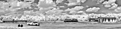 Americus Rails Panorama B&W (Neal3K) Tags: bw panorama sunlight clouds georgia landscape ir blackwhite infrared locomotive rrtracks rrdepot americusga kolarivision