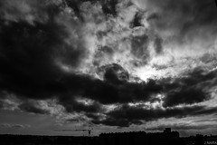 Dark Skies (Vienna) (JNARA300) Tags: vienna wien light sky bw panorama white black weather clouds canon dark landscape austria sterreich amazing europa europe skies view wolken 1855mm nara wetter dunkle lightroom t3i 18mm simmering 600d jaskirt jnara
