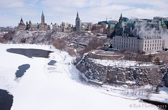 Downtown Ottawa from Victoria Island. Parliament buildings on the left and the Supreme Court on the right with the semi-frozen Ottawa River below. - Kite Aerial Photography (KAP) (Rob Huntley - Kite Aerial Photography) Tags: winter snow ontario canada cold ice water river photography photo ottawa freezing parliament photograph parliamenthill ottawariver supremecourt peacetower parliamentbuildings victoriaisland heatingplant cliffstreetheatingplant
