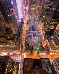 midtown worship on May 9, 2013 (mudpig) Tags: nyc newyorkcity longexposure ny fog skyline night geotagged golden cityscape cathedral madison gothamist stpatricks 30rockefellercenter thepalacehotel stevekelley stevenkelley