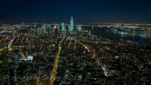 A view of Lower Manhattan from Empire State Observation Deck.	by Andrew Geary