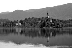 church of Assumption, Bled Island (chelseagirl) Tags: trees lake mountains reflection church water evening slovenia bled assumption