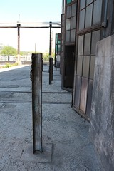 Chain barrier posts are made from railroad track (tomman) Tags: railroad yards urban yard train foundry factory decay albuquerque rail tvshowlocation railyard boiler filmlocation revitalize macgruber breakingbad terminatorsalvation
