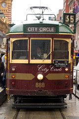 Melbourne Tram (Kokkai Ng) Tags: street old city travel red classic tourism rain circle maroon tram overcast australia melbourne financialdistrict transportation publictransport urbanscene modeoftransport victoriastate