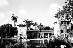 Venetian Pool 1924 (Phillip Pessar) Tags: camera bw white black film pool coral analog 35mm freedom minolta florida kodak miami places historic national venetian register dual gables tx400