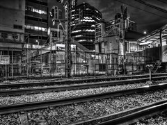 Midnight Train Station (DILLEmma Photography) Tags: blackandwhite bw white black cold art station japan skyline architecture night train wow dark dead lights tokyo amazing scary dangerous waiting rocks alone sad dismal nightshot image artistic cloudy threatening empty sony tracks atmosphere overcast dreary eerie pebbles tourist creepy spooky trouble international area stunning late void scared capture dim left desolate somber unhappy f828 murky deserted dusky dull hdr isolated timeless obscure frightening hopeless shadowy depressive sepulchral unoccupied disheartening disconsolate lightless discouraging comfortless depresssing