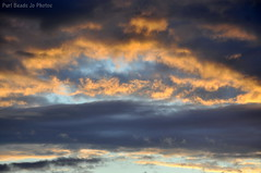 Fluffy Clouds with Sunset colours (Jo Southall) Tags: blue sky orange cloud sun water set dark fluffy cumulus vapour porecipitation