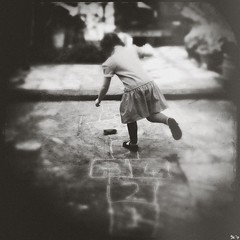 Hopscotch (Phoneographer) Tags: playing texture girl monochrome vintage garden square play action lincoln hopscotch hop blend iphone textureblend iphoneography hipstamatic