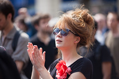 Applause (Monsieur Etienne) Tags: street portrait woman sun paris flower color colors girl earings sunglasses canon hair glasses dof bokeh candid longhair sunny f2 applause 135mm earing 5dmarkii
